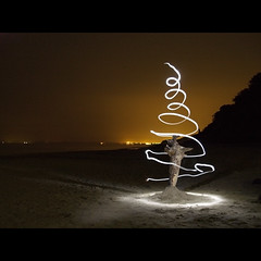 the lost christmas tree - part III : rebirth (Paul Petruck) Tags: longexposure beach night experiment surreal balticsea swirl usedom 1000views roq lightgames 10000views aplusphoto seenintheinterestingnessarchives ckeritz vacation2008