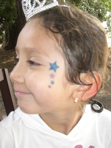 Star tattoo on the face of a child's cheek made permanently