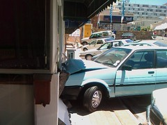 Car crashed into a wall in Kloof Street, Cape Town, Souith Africa (by Louis Rossouw)