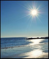 You Are My Sunshine... (jami_lee) Tags: ocean blue sun seagulls newyork beach coneyisland sand rocks sunny thechallengefactory
