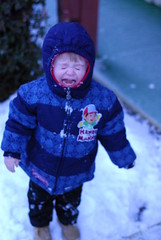 not to sure about this snow stuff (Paul Von Rieter) Tags: baby snow cold no crying like