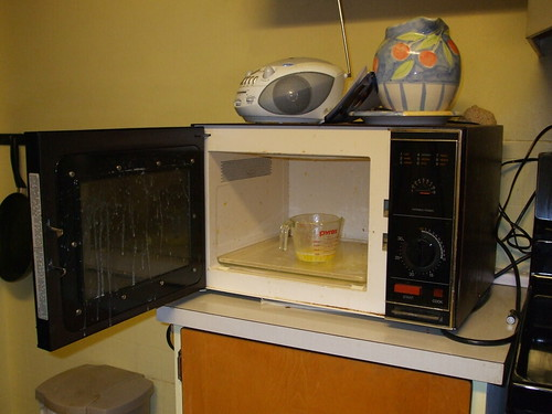 Butter all over the microwave.