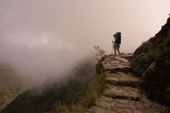 Over the Edge (Dave Schreier) Tags: road mist peru rock cane machu picchu fog inca stone standing alone hiking drop off trail backpack andes hiker mountians dropoff