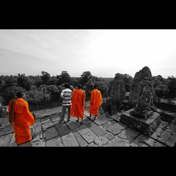 monks overlooking pre rup, Cambodia