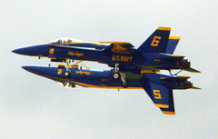 Blue Angels flys parallel, one upside-down