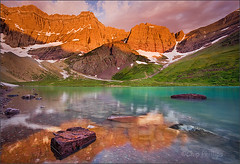 Cracker Lake Sunrise (Chip Phillips) Tags: park sunset red orange lake mountains green rock clouds sunrise landscape photography montana phillips glacier national chip cracker cloudscape alpenglow reflecion goldenglobe overtheexcellence
