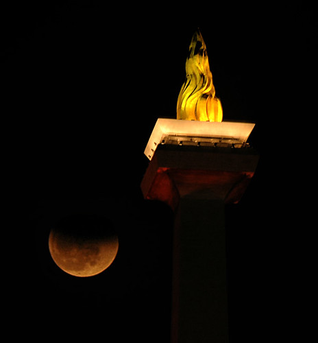 Lunar eclipse over Monas Jakarta