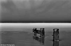 Groynes End (~Glen B~) Tags: sea sky bw white black beach night clouds coast sand surf smooth shore groyne silky redcar groynes verylongexposure redbubble:id=18177142groynesend