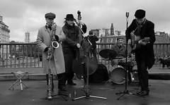 paris blues (march25/AnnaZ) Tags: people music paris men musicians blackwhite nikon december mood lumire streetphotography hl blackdiamond streetshot laseine annaz pontstlouis d80 ennoiretblanc copyrightedallrightsreserved coldbutwhocares