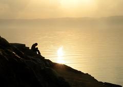 watching the sun sinking in the dead sea (angel_kuwaitya) Tags: sea sun man redsea watching jordan kuwait sinking thesun