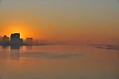 Arise (kkdlam) Tags: city reflection water skyline sunrise lights nikon downtown sandiego structure socal coronadobridge d700 nikond700