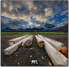Lead the way oh wise concrete... (Ryan Eng) Tags: blue sunset sky clouds hawaii oahu tripod symmetry direction spraypaint dri hdr gravel darkclouds greengrass sigma1020mm concretepillars nikond90 vertorama ryaneng ryausting