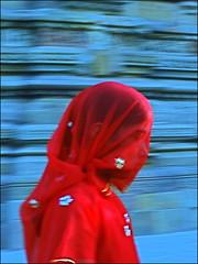 Sous le Voile (Christian Lagat) Tags: blue red woman india blur girl rouge veil femme bleu fille voile flou inde khajuraho madhyapradesh भारत nikkor50mmf18d 50millionmissing nikond40x