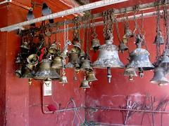 Temple bells (Linda DV) Tags: travel india canon geotagged temple assam 2008 sevensisters sivasagar sibsagar 7sisters northeastindia powershots5is lindadevolder sivadol