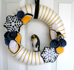 Antarctica Yarn Wreath (KnockKnocking) Tags: snowflake christmas blue winter sculpture sunlight white holiday snow black cold ice leaves rose yellow vintage penguin 3d mixed soft handmade unique navy glacier yarn wreath bead mustard environment chilly polar wonderland emperor global hanukkah millinery icecap