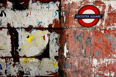 Leicester Square, Tube, London (greenwood100) Tags: old city uk pink blue red england white london texture sign wall underground subway advertising poster bright metro britain transport ripped vivid rail railway tunnel dirty billboard messy worn leicestersquare torn scratch decayed roundel scrape tfl scarp