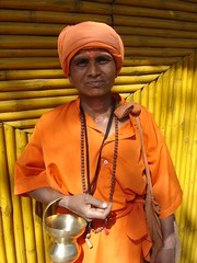 Sadhvi (Sirensongs) Tags: orange india women maharashtra hindu pune sadhu sadhvi sirensongs