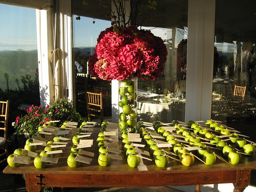 Wedding escort card table arrangement, Apples and hot pink hydrangea make for an imaginative escort card table combination,