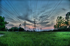 Power Down (FrostbytePhoto) Tags: blue sunset red sky sun grass lines power purple kitlens powerlines handheld dslr canonrebelxt hdr