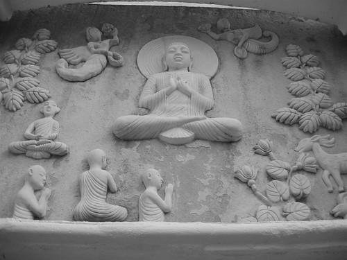 Buddha teaching in the Deer park statue
