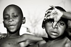 Good friends - Cape Maclear - Malawi (PascalBo) Tags: africa boy portrait people blackandwhite bw monochrome face kid nikon child hand d70 noiretblanc main malawi enfant lakemalawi visage garçon afrique southernafrica eastafrica lakenyasa lakeniassa capemaclear 123faves lakenyassa afriqueaustrale afriquedelest lacmalawi pascalboegli lpfaces lacnyasa lacnyassa lacniassa lpbandw