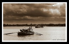 a cloudy morning from river hoogly (aruni sg) Tags: old sky cloud brown india art nature water canon boat dream s1 drama midday kolkata golddragon abigfave anawesomeshot superbmasterpiece ysplix theunforgettablepictures goldstaraward aruniphotography ahiritolahat kws100808kumartuli