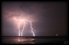 Lightning; My First Try (Kuzeytac) Tags: longexposure sea sky cloud storm reflection nature wet rain weather night photo amazing force purple extreme trkiye turkiye gr