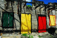Red, green and gold ! (jendayee) Tags: blue red green colors yellow wall grey amazingcolors dominica colorphotoaward