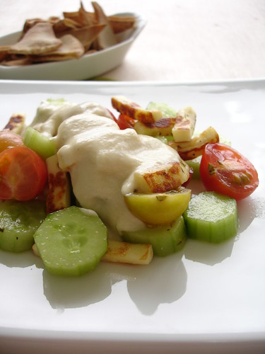 Cheese salad with hummus dressing and pitta crisps