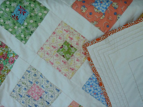 baby quilt detail, back, and binding