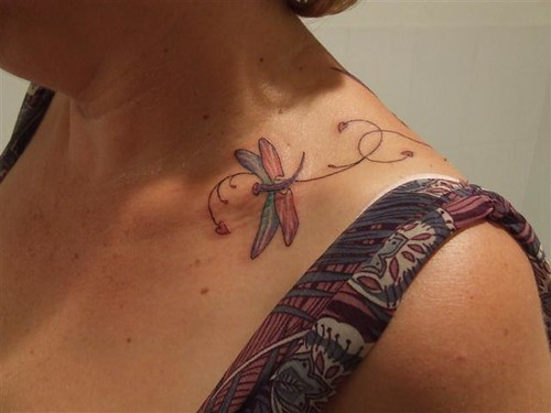 collar bone tattoo. Over the collar bone! Tough!