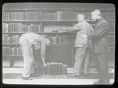 Three men at dusting books, one bent over (New York Public Library) Tags: newyork men standing work interior newyorkpubliclibrary books 1910s bookshelves shelves 1913 dusting xmlns:dc=httppurlorgdcelements11 dc:identifier=httpdigitalgallerynyplorgnypldigitalid1153324 dc:coverage=1913