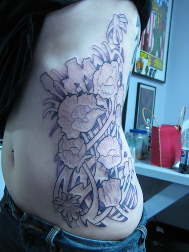 flower rib tattoos. rib tattoos. flower rib