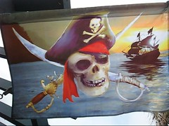 To All My Pirates friends ~ (Dominique Guillochon) Tags: california trees usa art beach colors shop windyday pier video day unitedstates sandiego flag pirates windy beachlife pb flags palmtrees pirate pacificbeach johnnydepp yohoho plank californiawinter californiacoast mutiny pirateflag captainjacksparrow shivermetimbers walktheplank ahoymatey videoofpirateflag videoofwindydayinpacificbeachcaliforniausa pirateflaginthewind videoofpirateflagonawindyday