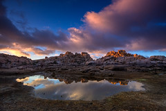 Dawn at Barker Dam (Jeffrey Sullivan) Tags: california park copyright usa lake reflection jeff nature clouds sunrise canon landscape dawn photo searchthebest january joshuatree calm southern national sullivan 2009 allrightsreserved 40d