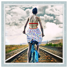 En Dónde Estés (Franklyn Espinal) Tags: girl bicycle rose tattoo clouds photoshop pedaling traintracks rosa surreal bicicleta nubes shorthair tatuaje ferrocarril polkadotdress ef50mmf14usm canoneos5d espinal whereveryouare aplusphoto wonderbreaddress endóndeestés venstidodebolitas