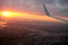 Flight over Manhattan (wallyg) Tags: nyc newyorkcity sunset ny newyork skyline plane airplane island manhattan flight aerial explore gothamist americanairlines