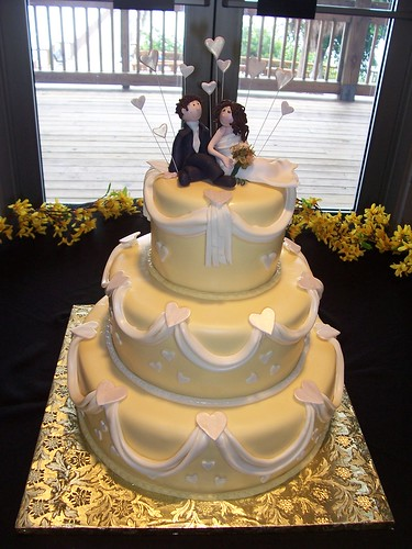 The yellow wedding cake color complimented the reception decor