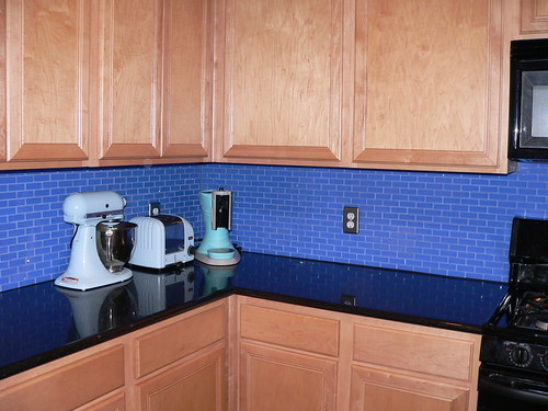 kitchen backsplash with 1x3 cornflower blue subway glass tiles
