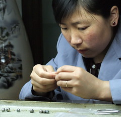 Pearls factory (markb120) Tags: china blue woman girl hair factory chinese pearls pearl earing