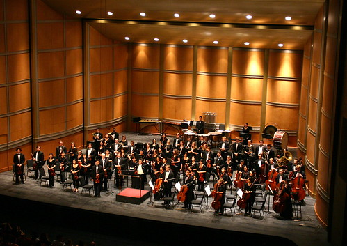 The orchestra takes a bow at the Shanghai Grand Theater. Although the performance space doubles as a theater, the fine orchestra shell makes the hall a great venue for orchestral music