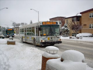 Two westbound Pace buses on Grand Avenue after a heavy overnight snowstorm. River Grove Illinois. January 2008.