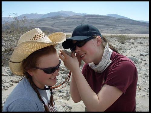 Sara Alsbury and Lauren Foiles use the ol teamwork method for rock identification.