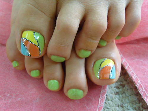 Broken glass style with colorful toe nail art design in baby blue, red, green, yellow nail art colors.