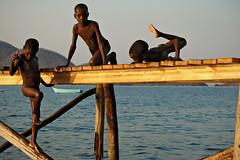 Three boys playing on a pier for boats above Lake Malawi - Cape Maclear (PascalBo) Tags: africa boy people kid nikon child d70 malawi enfant lakemalawi garçon afrique southernafrica eastafrica lakenyasa lakeniassa capemaclear 123faves lakenyassa afriqueaustrale afriquedelest lacmalawi pascalboegli lacnyasa lacnyassa lacniassa