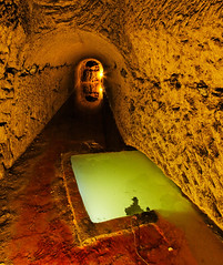 Water (Esprit de sel) Tags: orange green water catchycolors underground chalk eau tank quarry 1022mm craie rigole bassin carrire souterraine rservoir goulotte calcification arnaudet