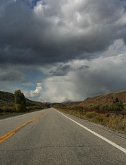 Vanishing highway (EMan Ian) Tags: road trees sky mountains clouds highway colorado cloudy overcast tokina1224 tokina valley rockymountains stormclouds