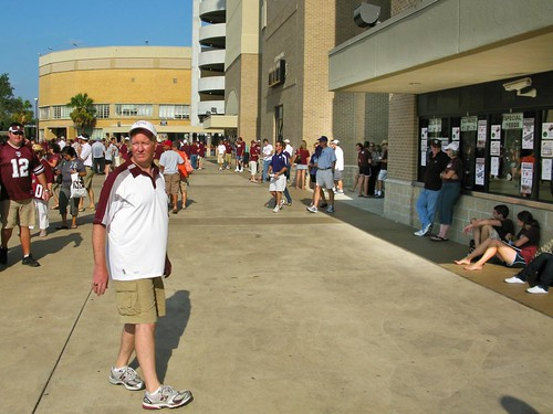 """Could this guy be regretting his plan to """"Meet just outside the stadium""""?  """"I'll be the guy in the Aggie shirt"""" never really works well in College Station.  Worry not though..."""