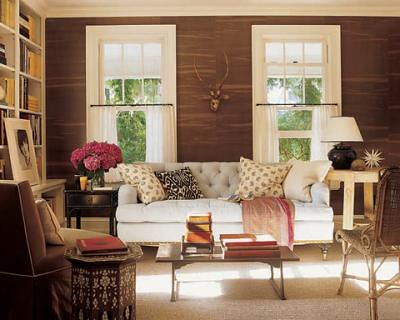 Warm neutral mix: Brown + white + ikat in Hamptons living room by Jeffrey Bilhuber, from Elle Decor