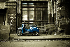 Blue vespa (manganite) Tags: old blue windows color berlin brick topf25 bike wall sepia architecture facade contrast digital buildings cutout germany dark geotagged interestingness topf50 backyard nikon colorful europe vespa tl stones decay scooter explore motor d200 rotten nikkor dslr toned vignette prenzlauerberg cycles selective schwalbe interestingness221 i500 18200mmf3556 utatafeature manganite nikonstunninggallery ipernity theperfectphotographer date:year=2008 geo:lat=52529598 geo:lon=13411203 date:month=february date:day=24 format:ratio=32 stadtgetty2010